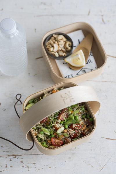 Foto van Quinoa met honingtomaatjes, erwtjes, wortel en cashewnoten